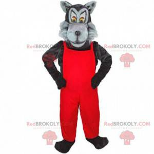 Graues und schwarzes Wolfsmaskottchen mit rotem Overall -