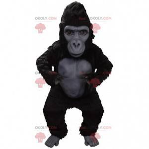 Mascote gorila negro gigante, muito realista e intimidante -