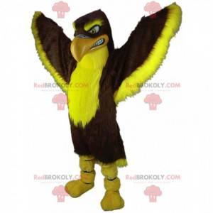 Hnědý a žlutý maskot sokola, kostým velkého orla -