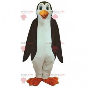 Mascote de pinguim gigante com olhos azuis, fantasia de pinguim