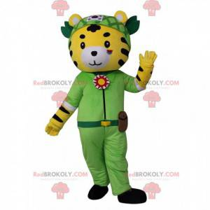 Yellow, white and black tiger mascot in adventurer outfit -