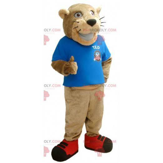 Beige Tiger Maskottchen mit einem blauen T-Shirt -