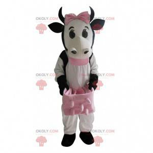 Mascot vaca blanca y negra con urracas rosadas - Redbrokoly.com