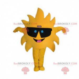 Riesiges gelbes Sonnenmaskottchen mit schwarzer Brille -