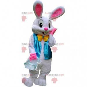 Mascotte coniglio bianco e rosa con un giubbotto blu -