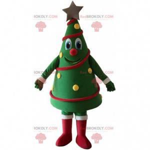 Kerstboom mascotte versierd en glimlachend, kerstkostuum -