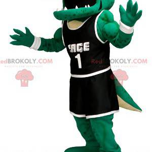 Grünes Krokodilmaskottchen in schwarzer Sportbekleidung -