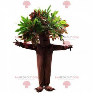 Mascote gigante com tronco grande e folhas verdes -