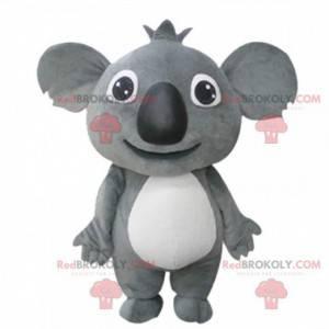 Reusachtige en ontroerende grijze koala-mascotte, pluche koala