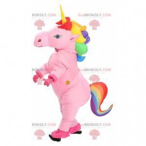 Roze opblaasbare eenhoorn mascotte met veelkleurige manen -