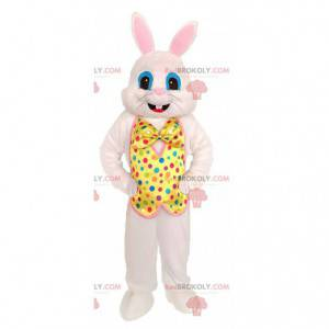 White rabbit mascot with a yellow vest with colored dots -