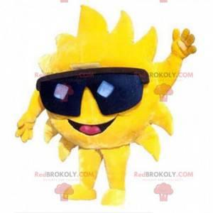 Mascote gigante do sol amarelo com óculos pretos -