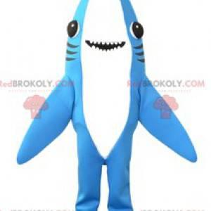 Mascote tubarão gigante e super sorridente de tubarão azul e