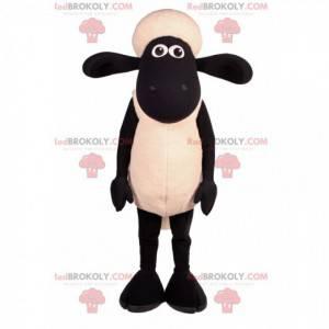 Mascote ovelha preto e branco com orelhas grandes -