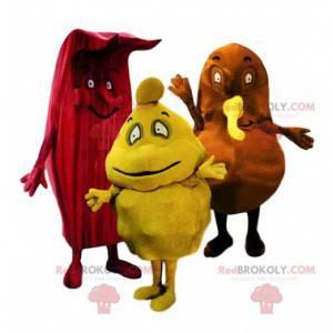 Trojice podivných červených, žlutých a hnědých maskotů -