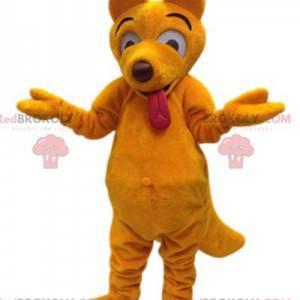 Gele dingo wolf mascotte en zijn grappig gezicht -