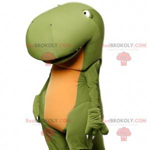 Mascote de dinossauro verde super engraçado com seu nariz