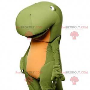 Super divertente mascotte di dinosauro verde con il suo enorme