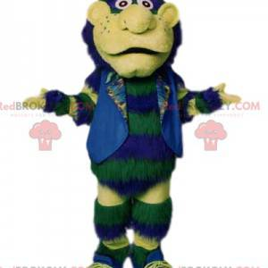 Green snowman mascot with his jacket and blue hat -