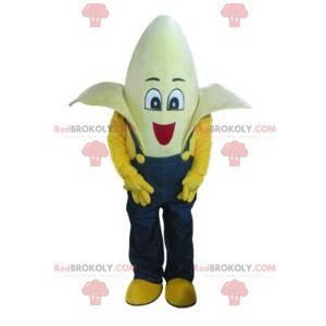 Mascote banana super engraçado com seu macacão azul -