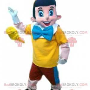 Mascota de Pinocho y su traje rojo, amarillo y azul -
