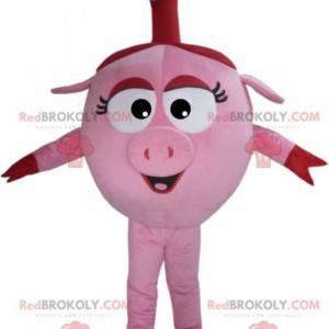 Mascota linda cerda rosa con su pequeña flor azul -