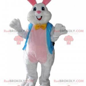 Jedwabisty biały królik maskotka z jego błękitną kamizelką -
