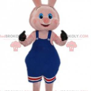 Maskottchen kleines rosa Schwein mit seinem blauen Overall -