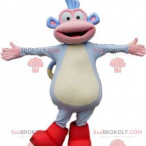 Mascote engraçado macaquinho azul com suas botas vermelhas -