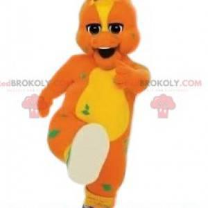 Mascot pato naranja y amarillo y su par de baloncesto verde -