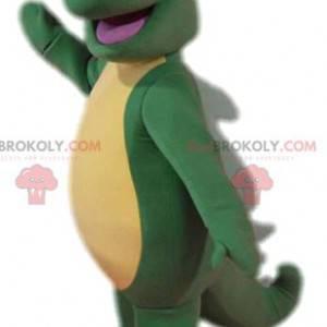 Super komische groene hagedismascotte met zijn grote staart -