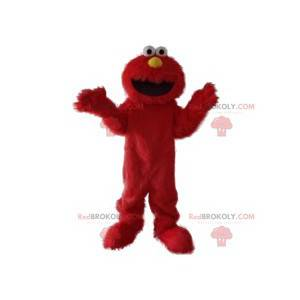 Mascota del monstruo rojo peludo divertido y sonriente -