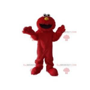 Mascotte mostro rosso peloso divertente e sorridente -