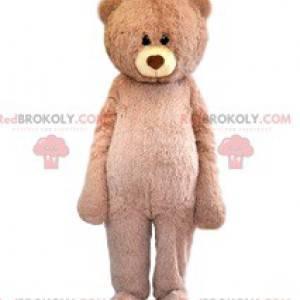 Příliš roztomilý maskot béžového medvěda s jeho něžným pohledem
