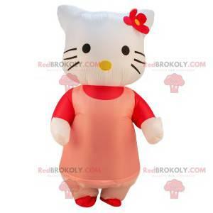 Mascota de Hello Kitty con su vestido rosa y flor roja -