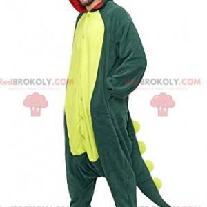 Grünes Dinosaurier-Maskottchen mit seinem schönen gelben Wappen