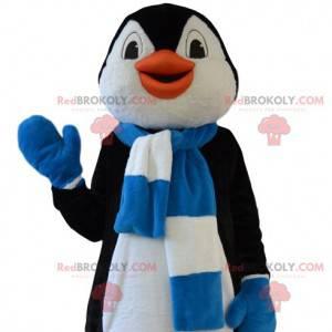 Mascota divertida del pingüino con su bufanda azul y blanca -