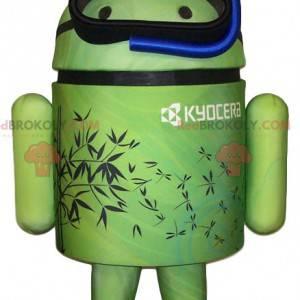 Maskottchen grüner Android mit seiner blauen Tuba -