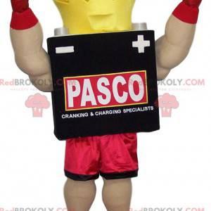 Boxermaskottchen mit gelber Krone und roten Shorts -