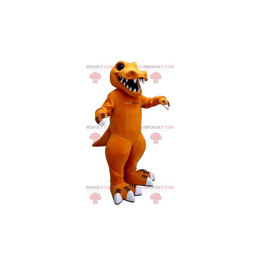 Oranžový a bílý dinosaurus maskot s velkými zuby -