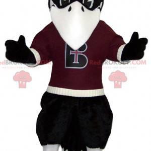 Maskot černého orla s jeho bordovým dresem - Redbrokoly.com