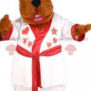 Weiches rotes Bärenmaskottchen mit seinem weißen Bademantel -
