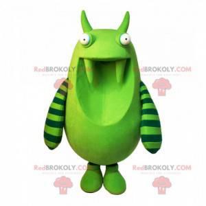Mascote gigante monstro verde com dentes grandes -
