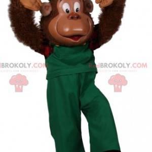Mascote macaco cômico de macacão verde - Redbrokoly.com