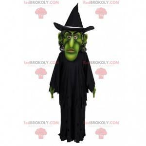 Zelený čaroděj maskot s pláštěnkou a černým kloboukem -