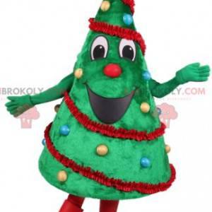 Grüntannenmaskottchen mit seiner Weihnachtsdekoration -