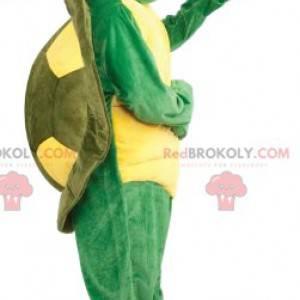 super fröhliches gelbes und grünes Schildkrötenmaskottchen -