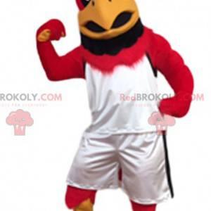 Obří červený orel maskot s jeho sportovní oblečení -