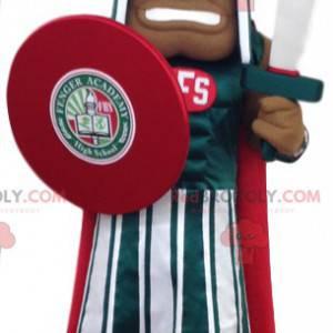 Mascota de soldado romano en traje oficial rojo y verde -