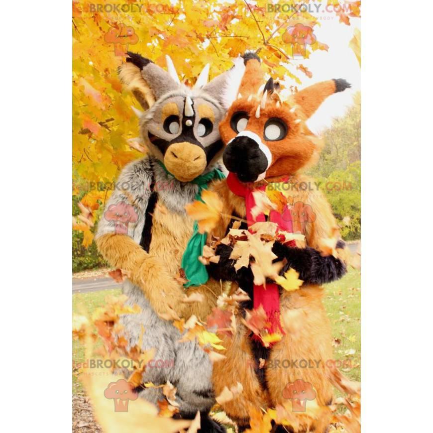 2 Maskottchen von sehr bunten fantastischen Kreaturen -